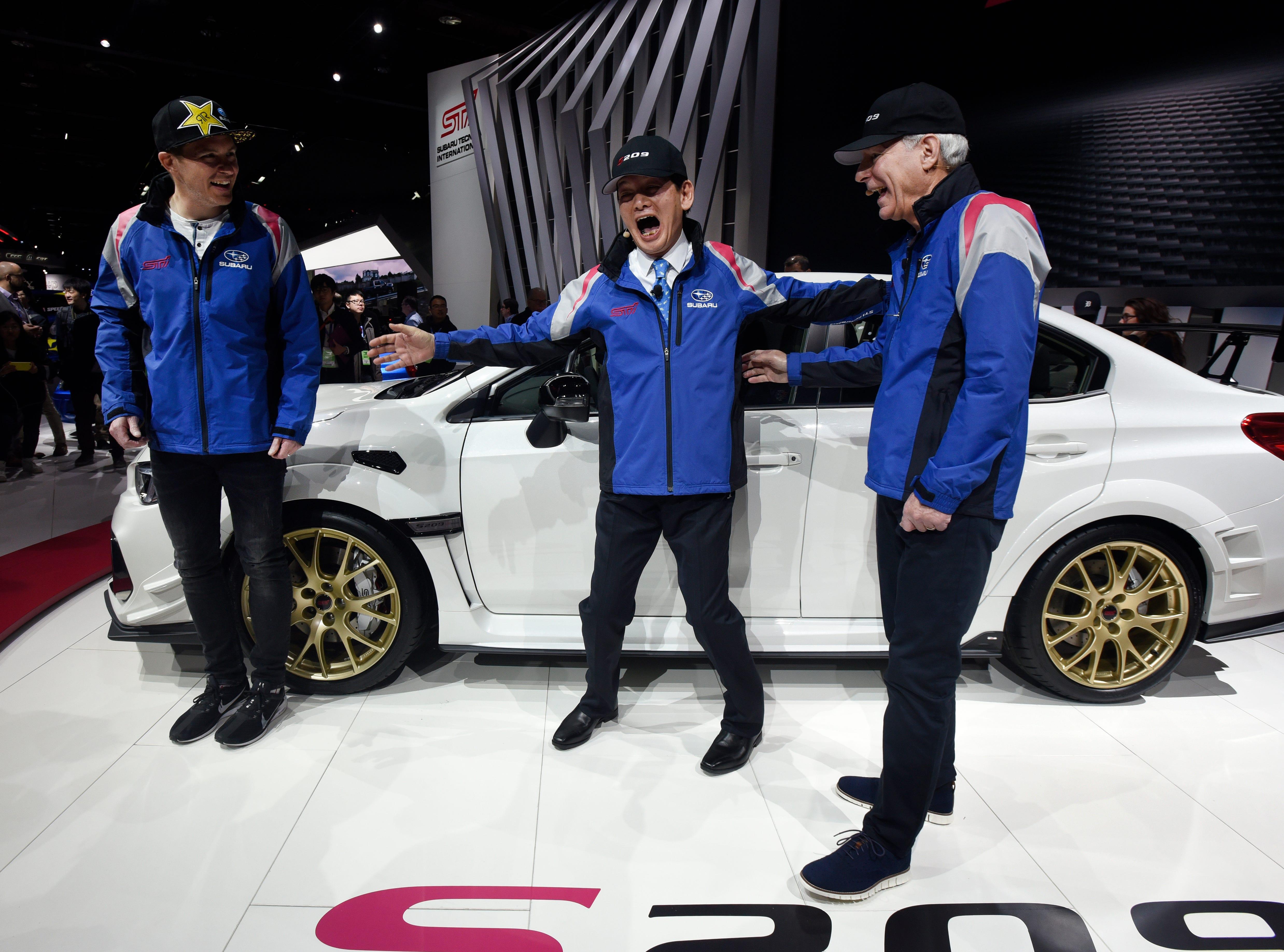 Subaru Motorsports driver Scott Speed, left, Subaru Tecnica International President Yoshio Hirakawa and Subaru of America Inc. President CEO Tom Doll share a laugh following the unveiling of the STI S209.