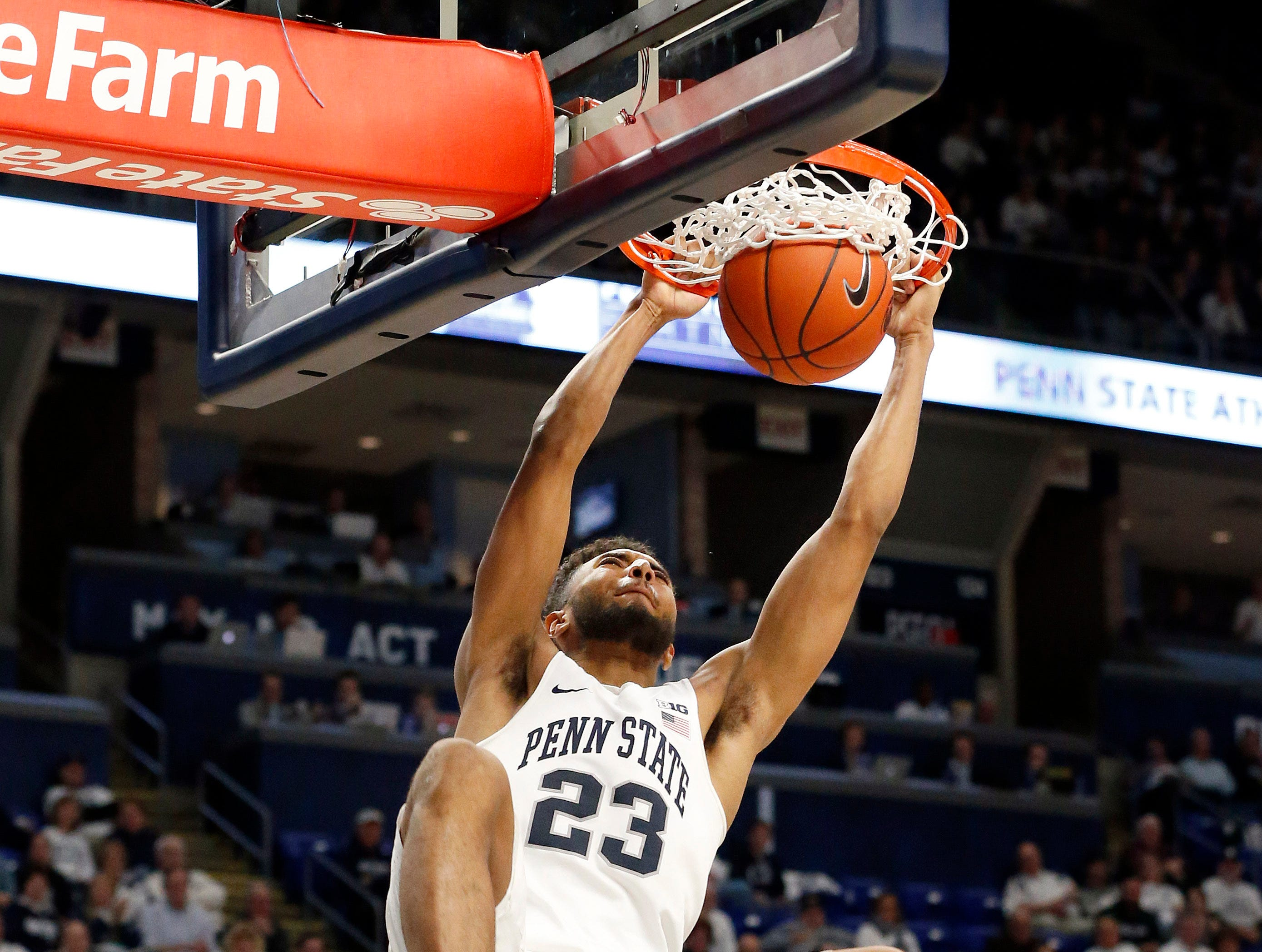 Penn State's Josh Reaves (23) dunks against Michigan State during second-half action of an NCAA college basketball game in State College, Pa. Sunday, Jan. 13, 2019. (AP Photo/Chris Knight)