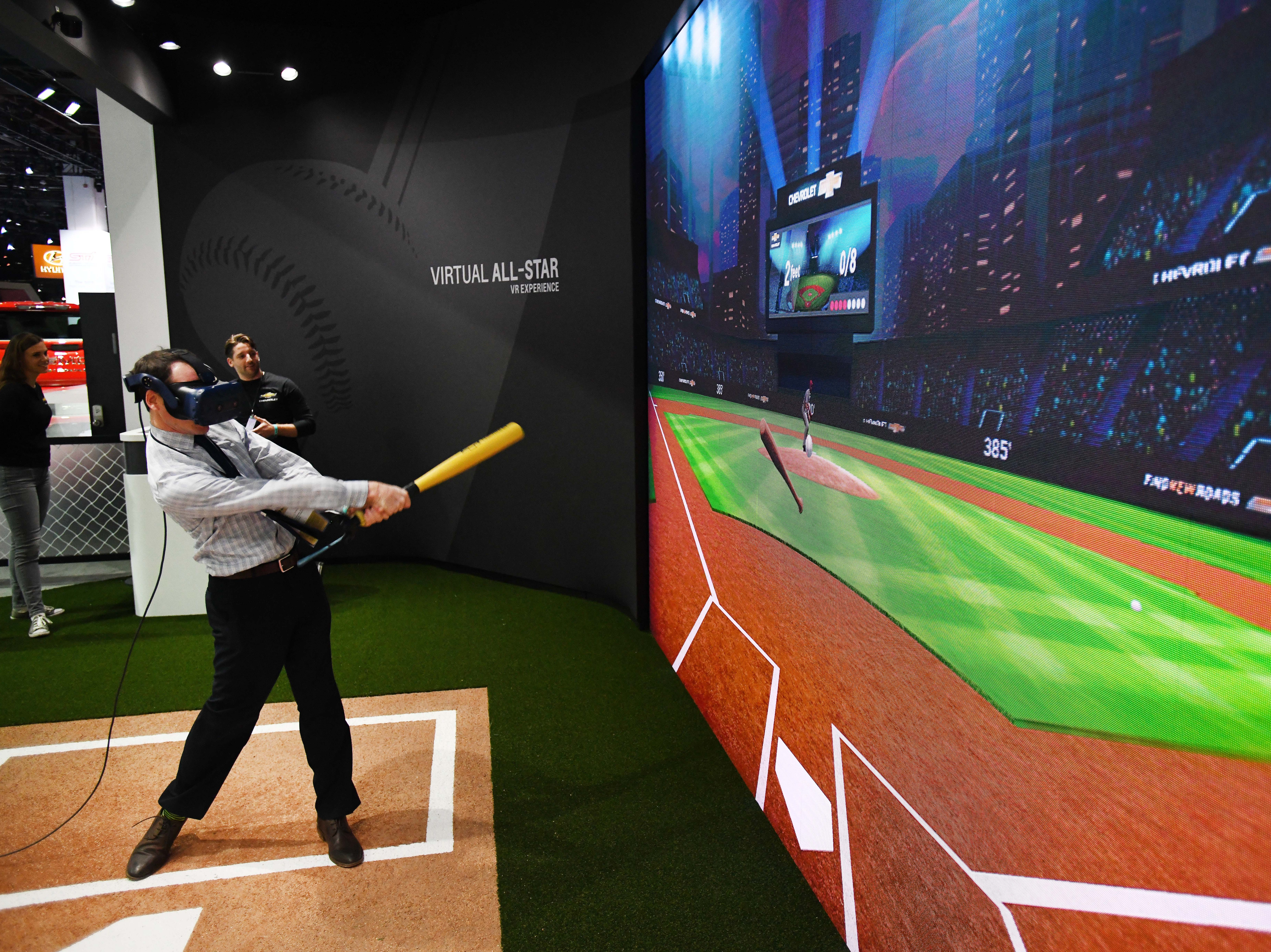Todd Wasik takes a whack at the Chevrolet Virtual All- Star experience at the North American International Auto Show.