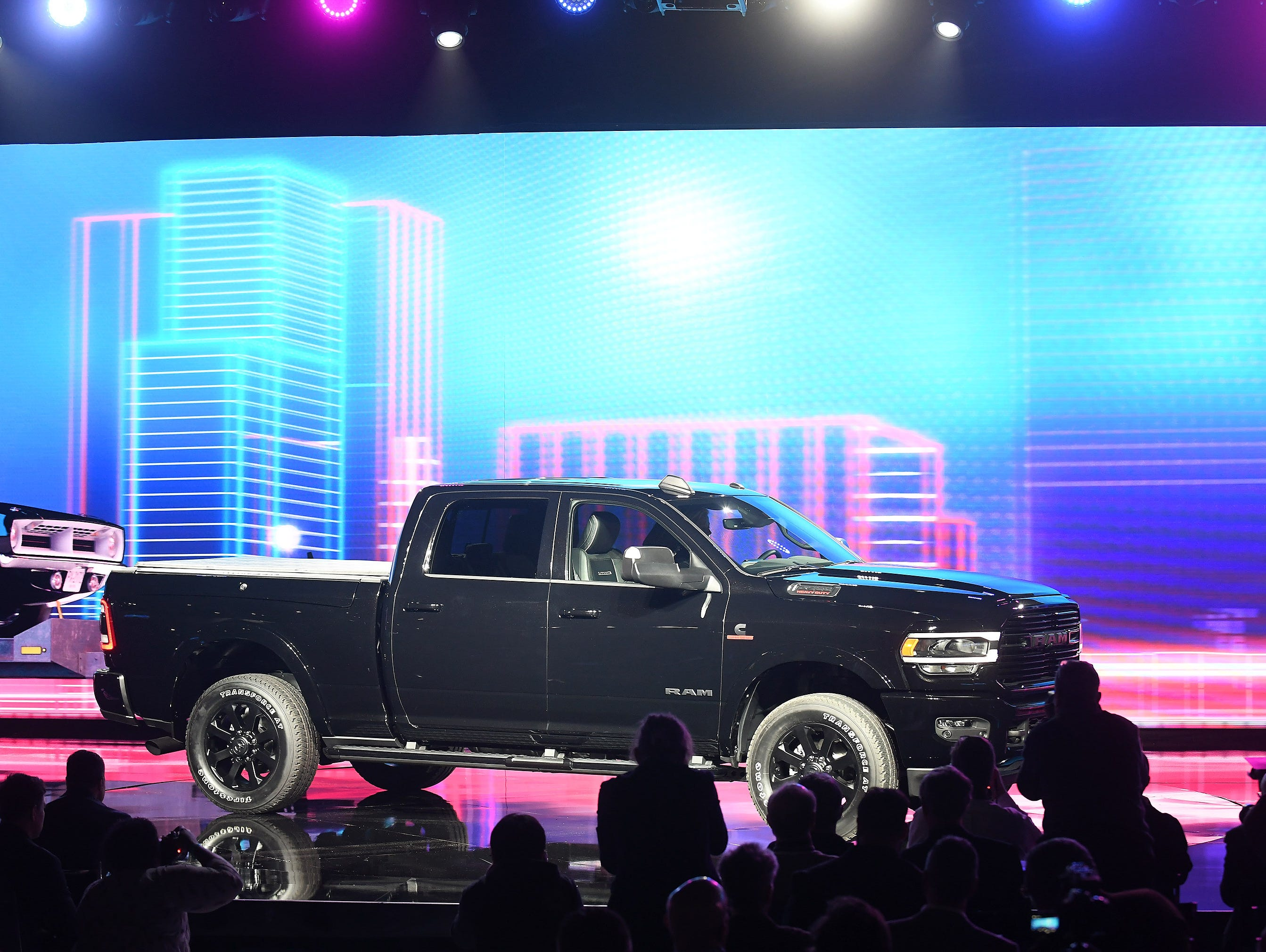 The 2019 Ram Heavy Duty 2500 drives on stage.