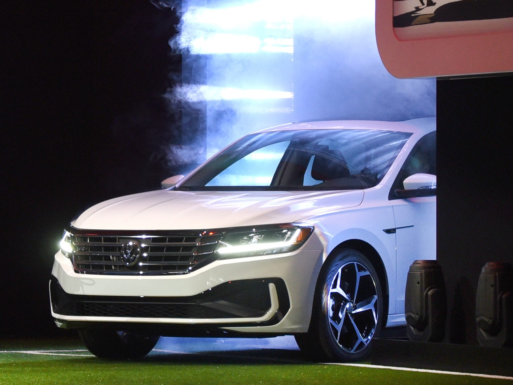 Cameras roll as the 2020 Volkswagen Passat clears the smoke at the Detroit International Auto Show at Cobo Center on Monday, Jan. 14, 2019.