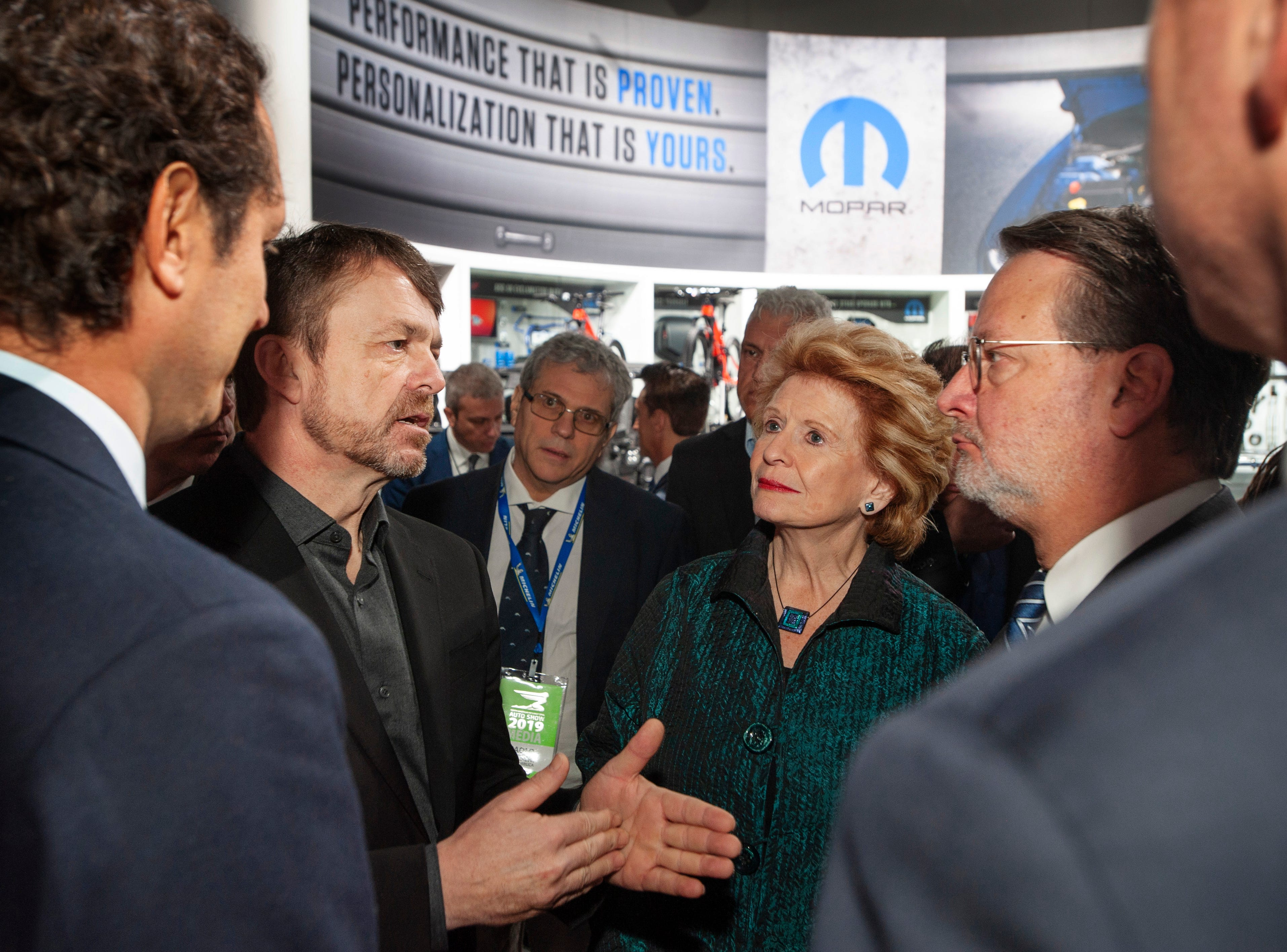 Fiat Chrysler Automobiles CEO Mike Manley speaks with U.S. Sens. Debbie Stabenow and Gary Peters, right, along with FCA Chairman John Elkann, far left, during the politicians' visit to the FCA exhibit space at the North American International Auto Show in Detroit on Monday, Jan. 14, 2019.