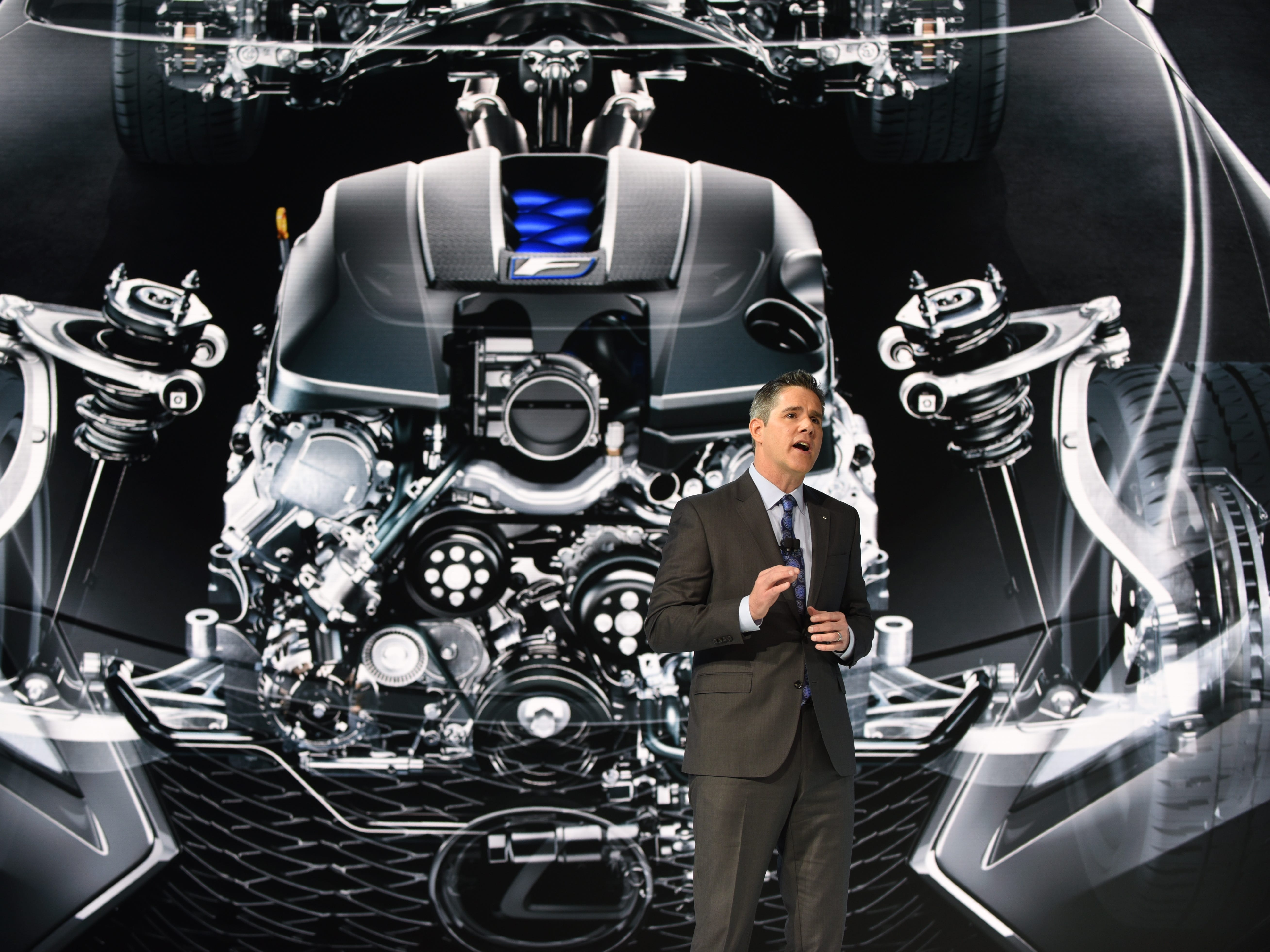 David Christ, Group President and General Manager, Lexus Division, displays the engine of the Lexus RC F Track Edition.