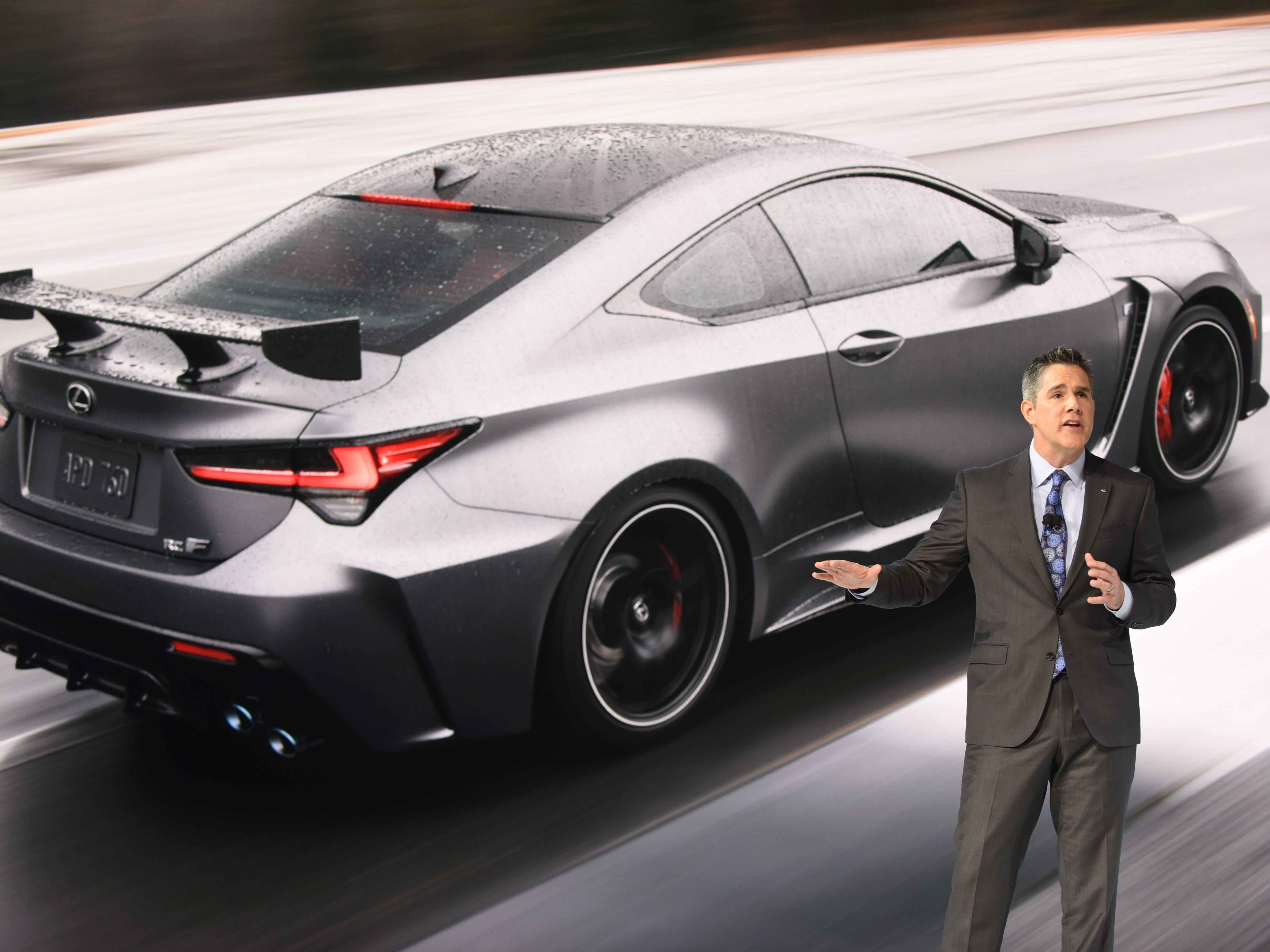 David Christ, group president and general manager of Lexus Division, unveils the Lexus RC F Track Edition at the Detroit auto show Monday.