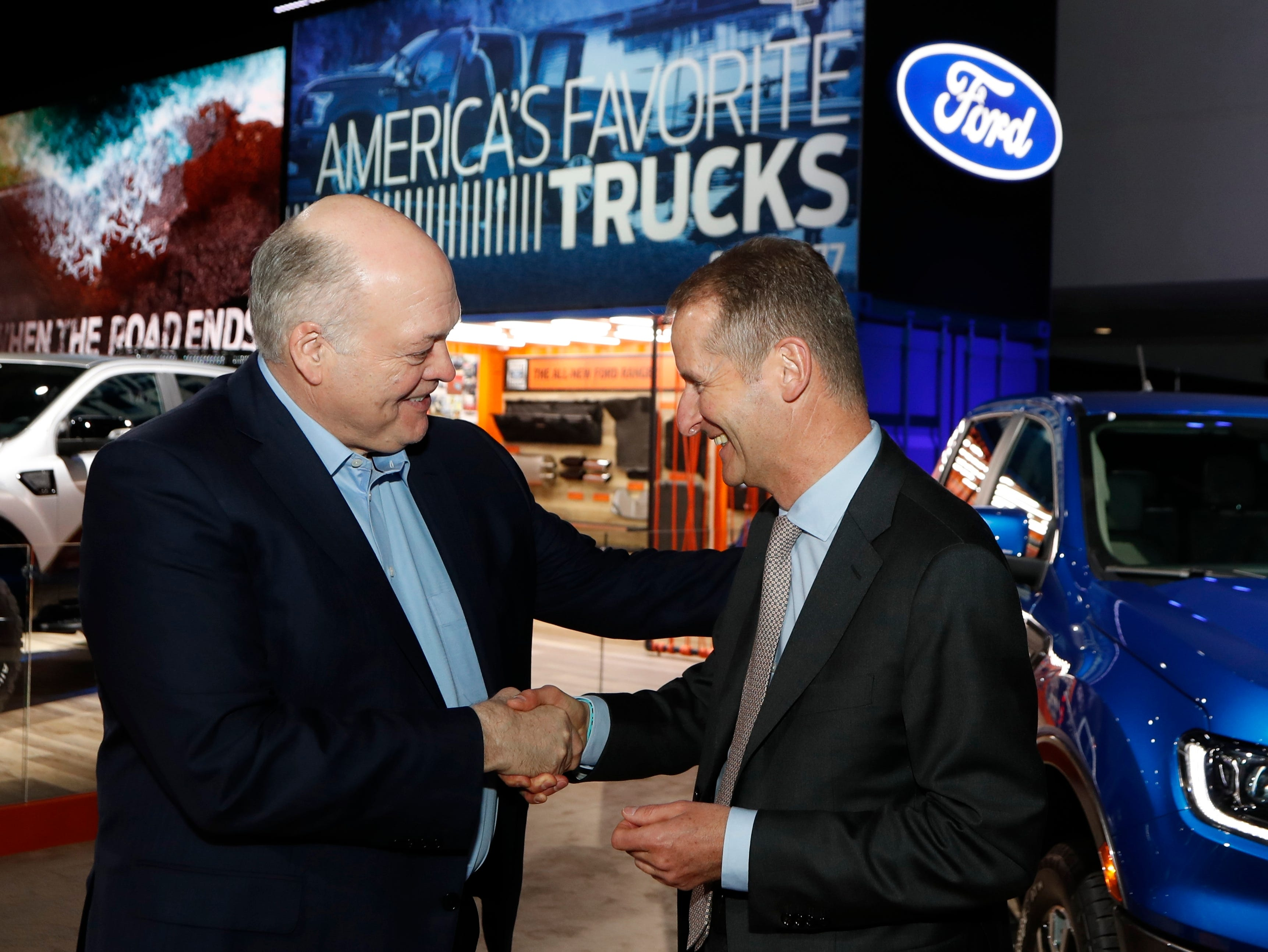Ford Motor Co. President and CEO Jim Hackett, left, meets with Herbert Diess, CEO of Volkswagen AG, Monday, Jan. 14, 2019, at the North American International Auto Show in Detroit.