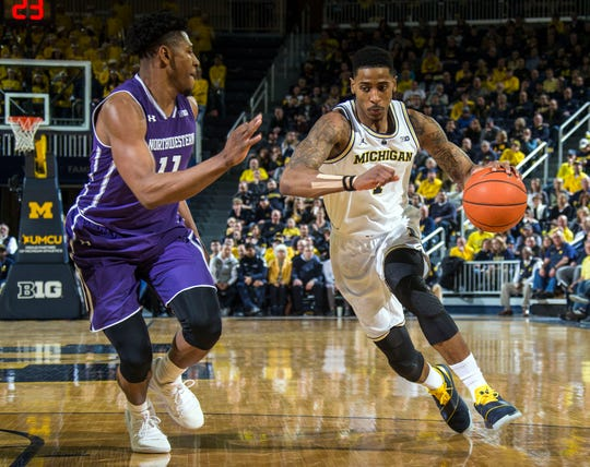 Guard Charles Matthews, right, was one of four Michigan starters to take at least nine shots and score in double figures Sunday night against Northwestern.