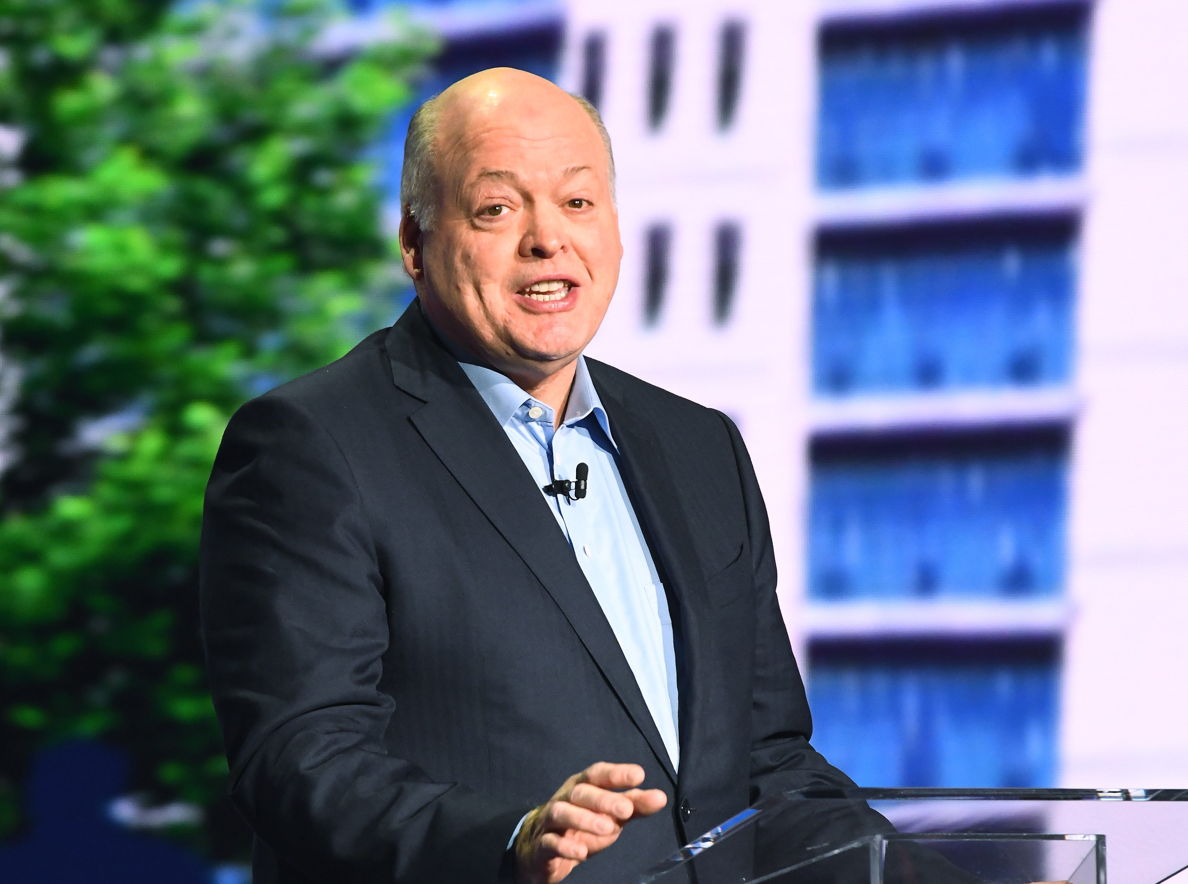 Ford President and CEO Jim Hackett speaks on stage during the Ford Explorer Hybrid reveal.
