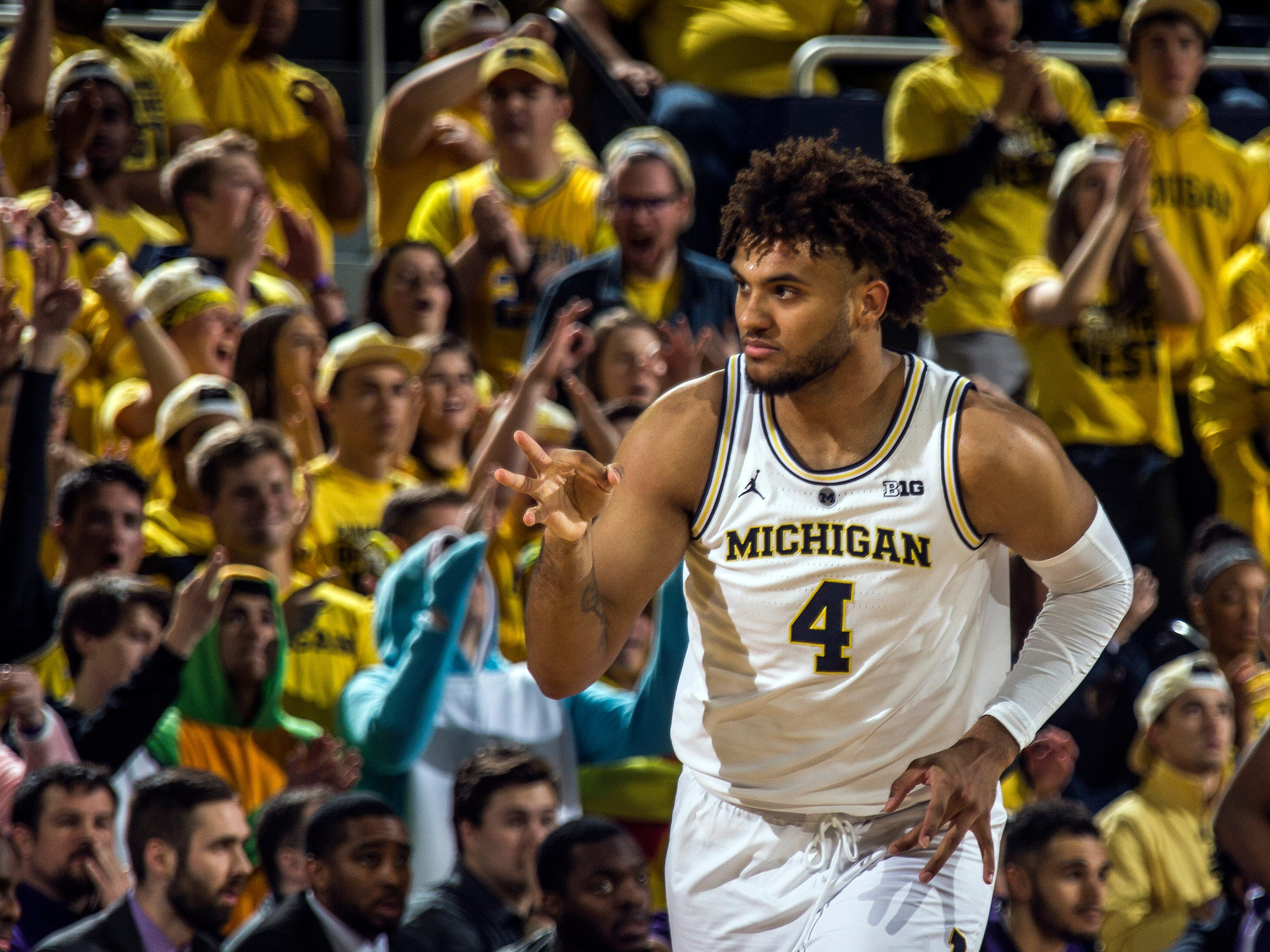 Michigan forward Isaiah Livers (4) celebrates making a three pointer in the first half.