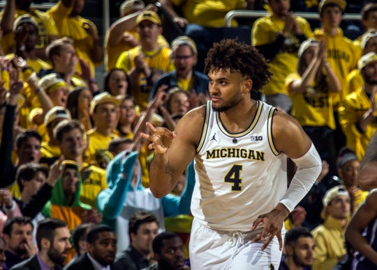 Forward Isaiah Livers celebrates making a 3-pointer in the first half as Michigan was 11-of-27 from beyond the arc in Sunday's 80-60 victory over Northwestern.