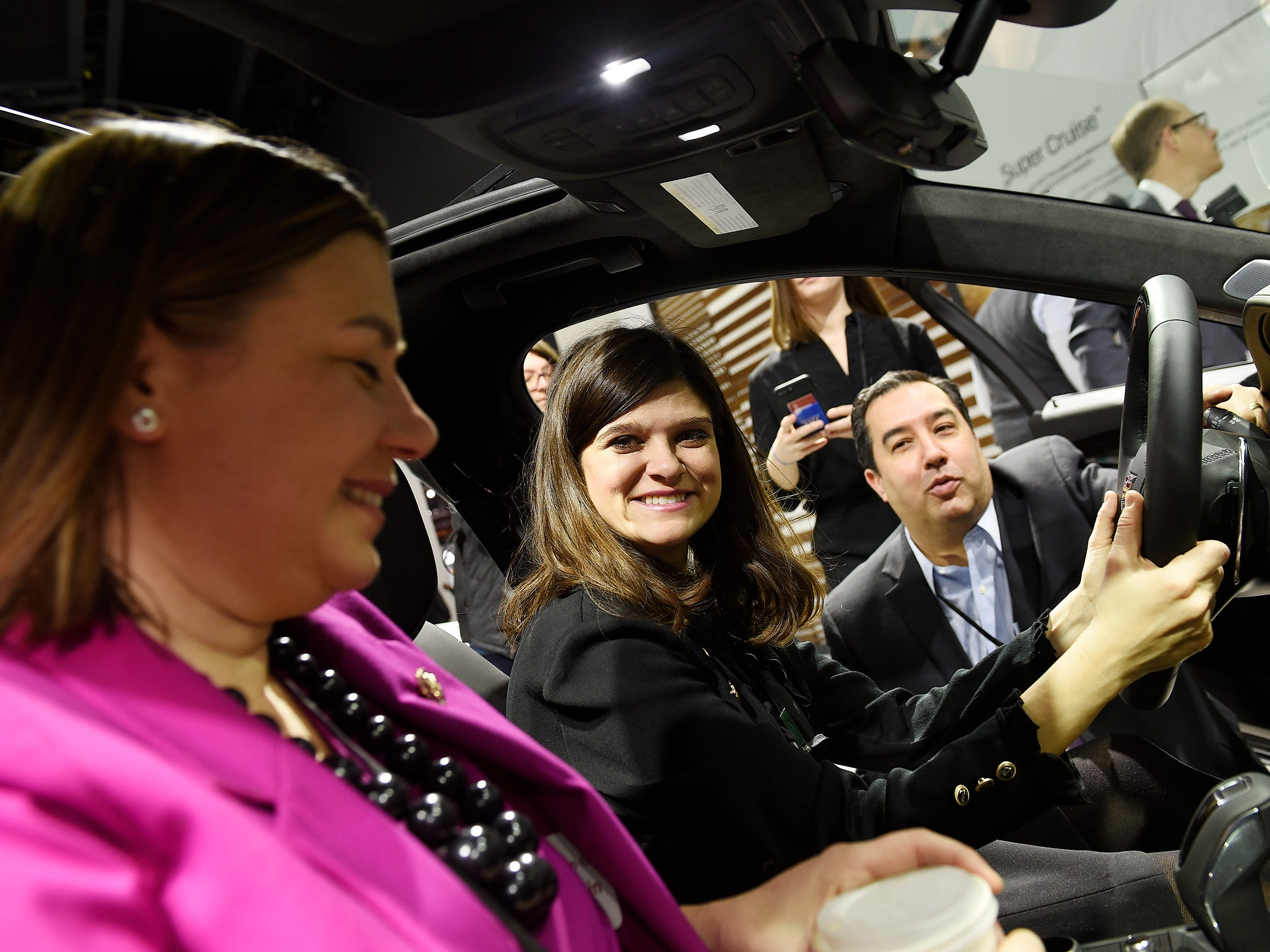 Richard F. Lopez, director of federal and administration affairs at GM, gives Michigan Congresswomen Haley Stevens, center, and Elissa Slotkin a description of the new Cadillac CT6 during the tour.