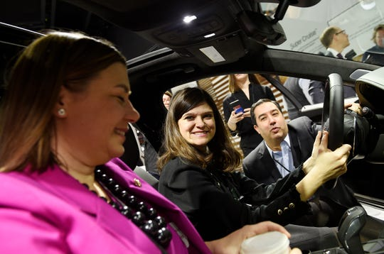 Richard F. Lopez, director of federal and administration affairs for GM, gives U.S. Reps. Haley Stevens, center, and Elissa Slotkin a description of the new 2019 Cadillac CT6 during atour.