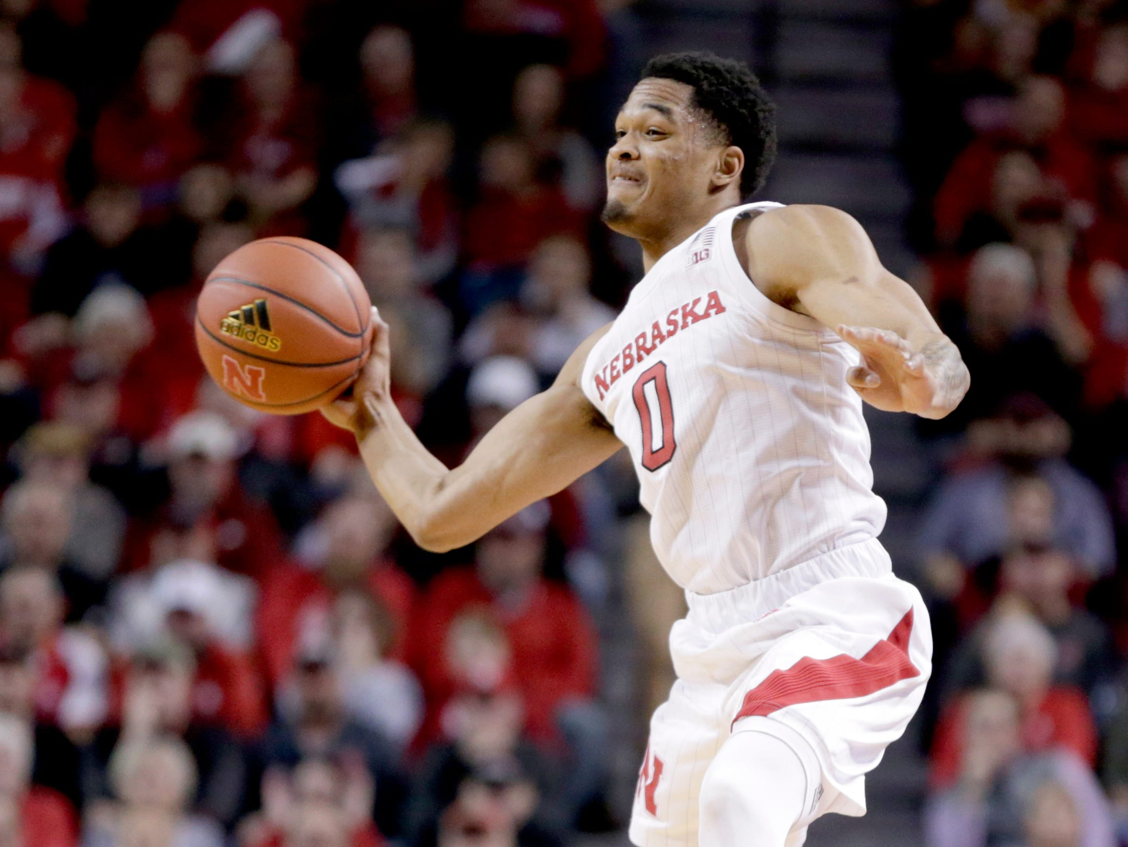 Nebraska's James Palmer Jr. (0) passes the ball during the first half of an NCAA college basketball game against Penn State in Lincoln, Neb., Thursday, Jan. 10, 2019. (AP Photo/Nati Harnik)
