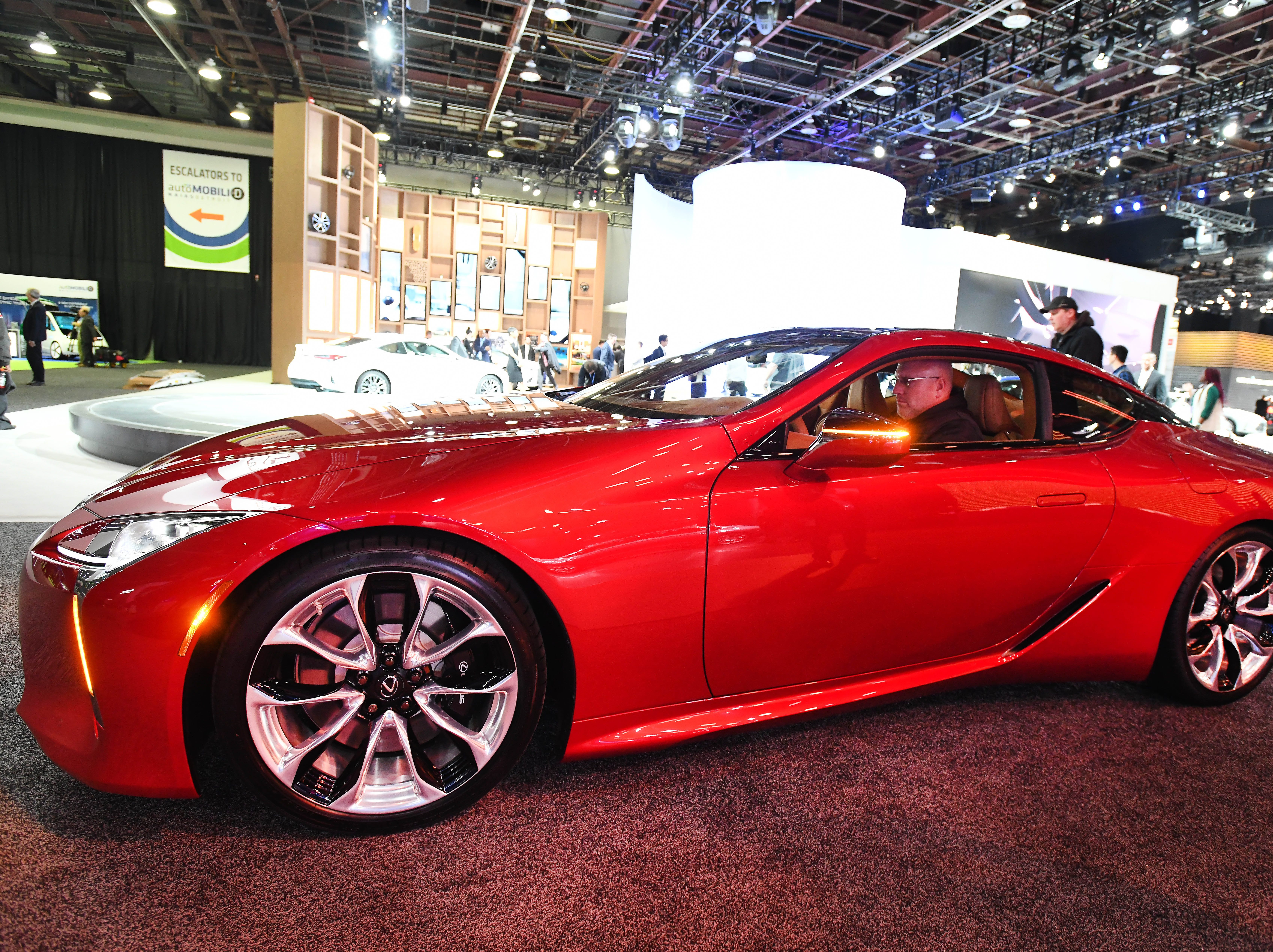 The LC500 is moved into the Lexus display area at the Detroit auto show Monday.