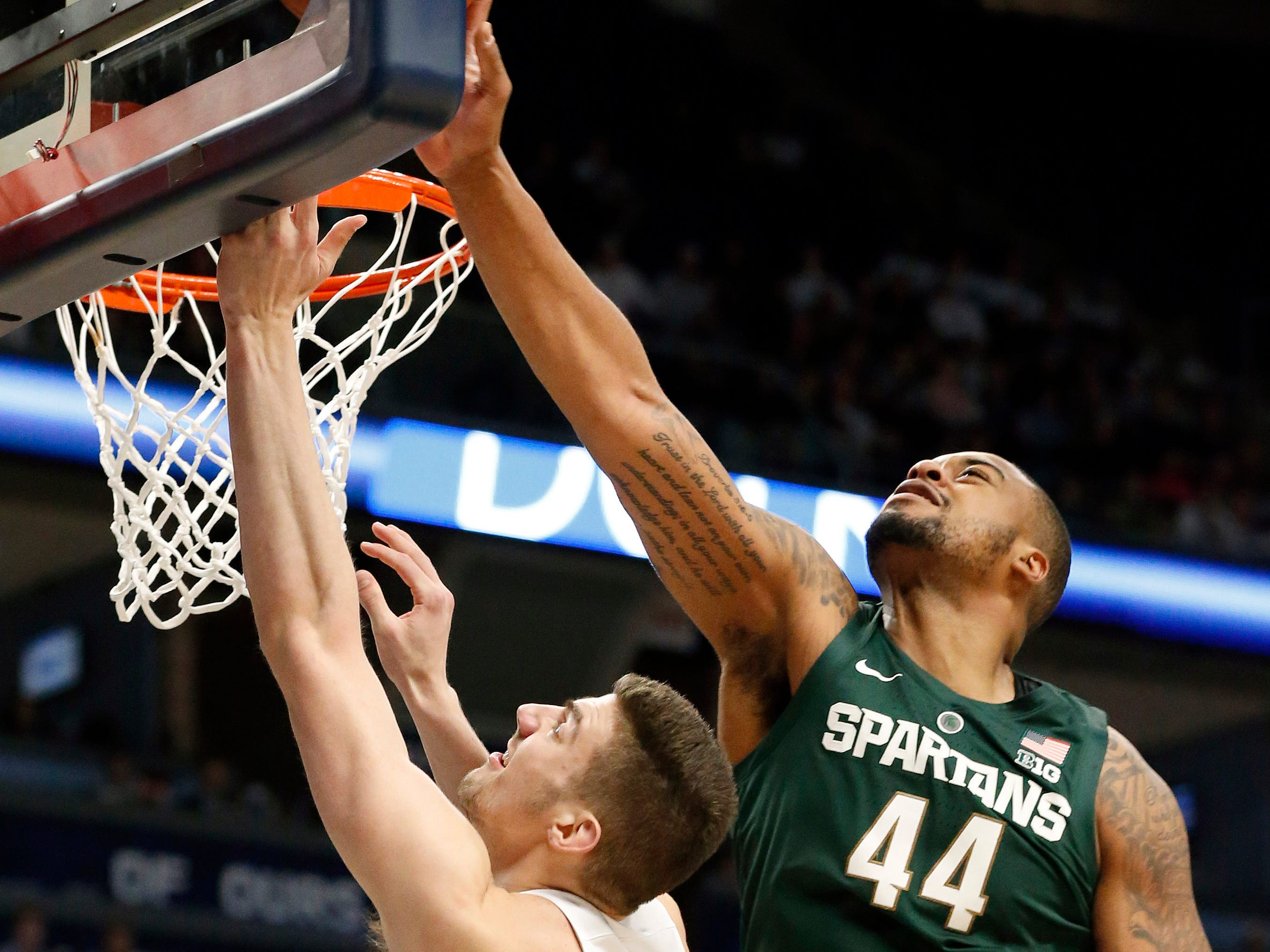 Michigan State's Nick Ward (44) blocks a shot by Penn State's Trent Butrick (35) during second-half action.