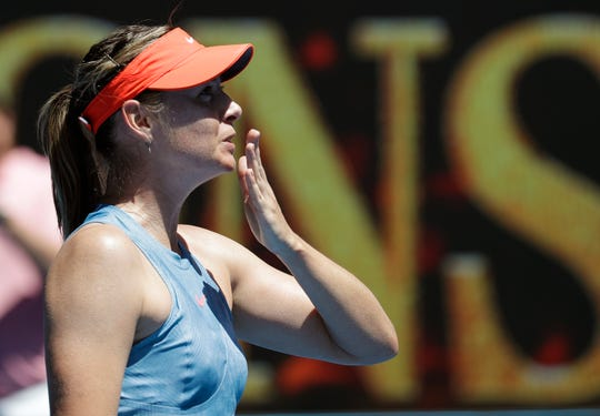 Russia's Maria Sharapova celebrates after defeating Britain's Harriet Dart during their first round match Monday.