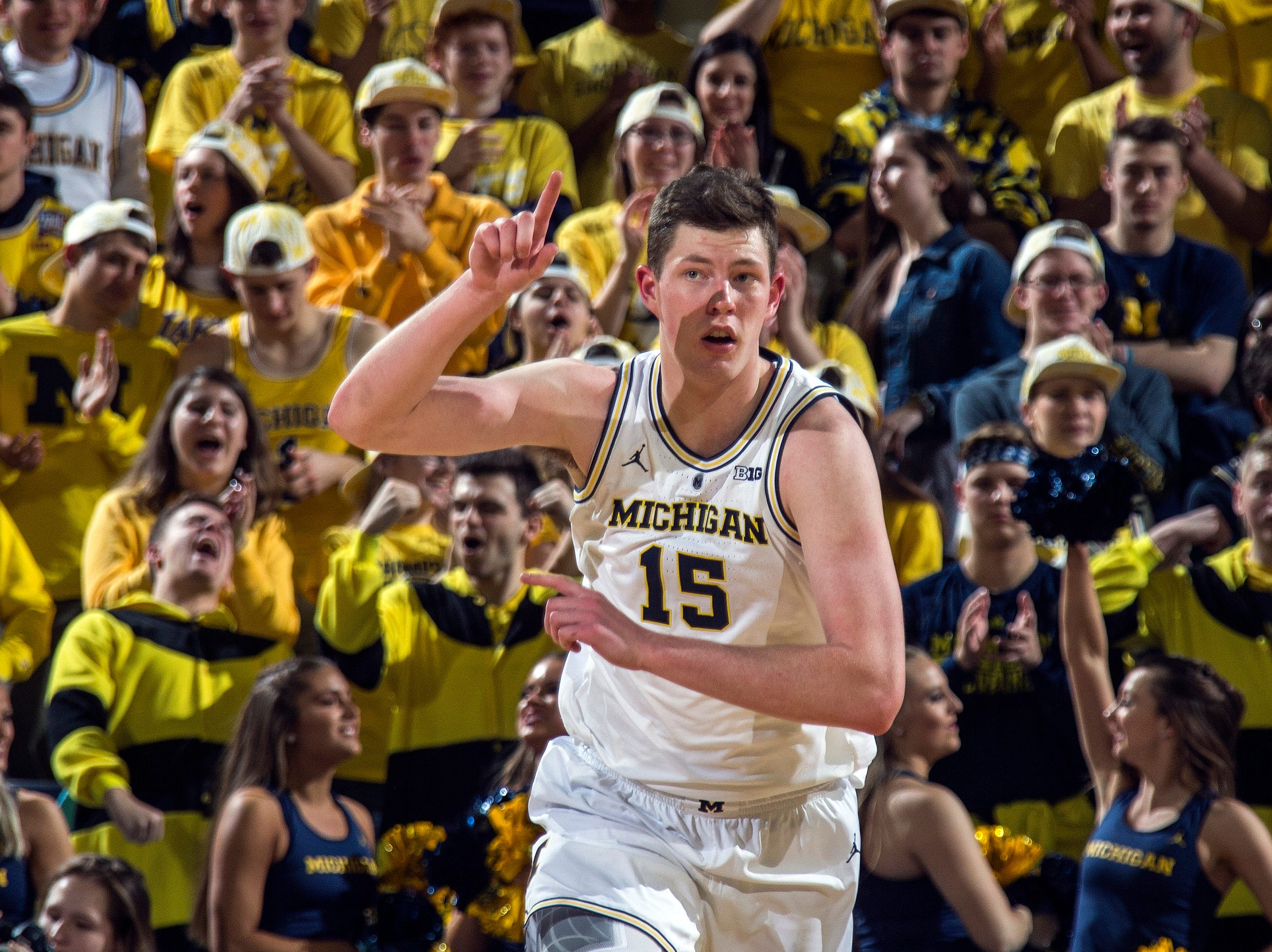 Michigan center Jon Teske (15) reacts after making a basket in the first half of an NCAA college basketball game against Northwestern at Crisler Center in Ann Arbor, Mich., Sunday, Jan. 13, 2019. (AP Photo/Tony Ding)