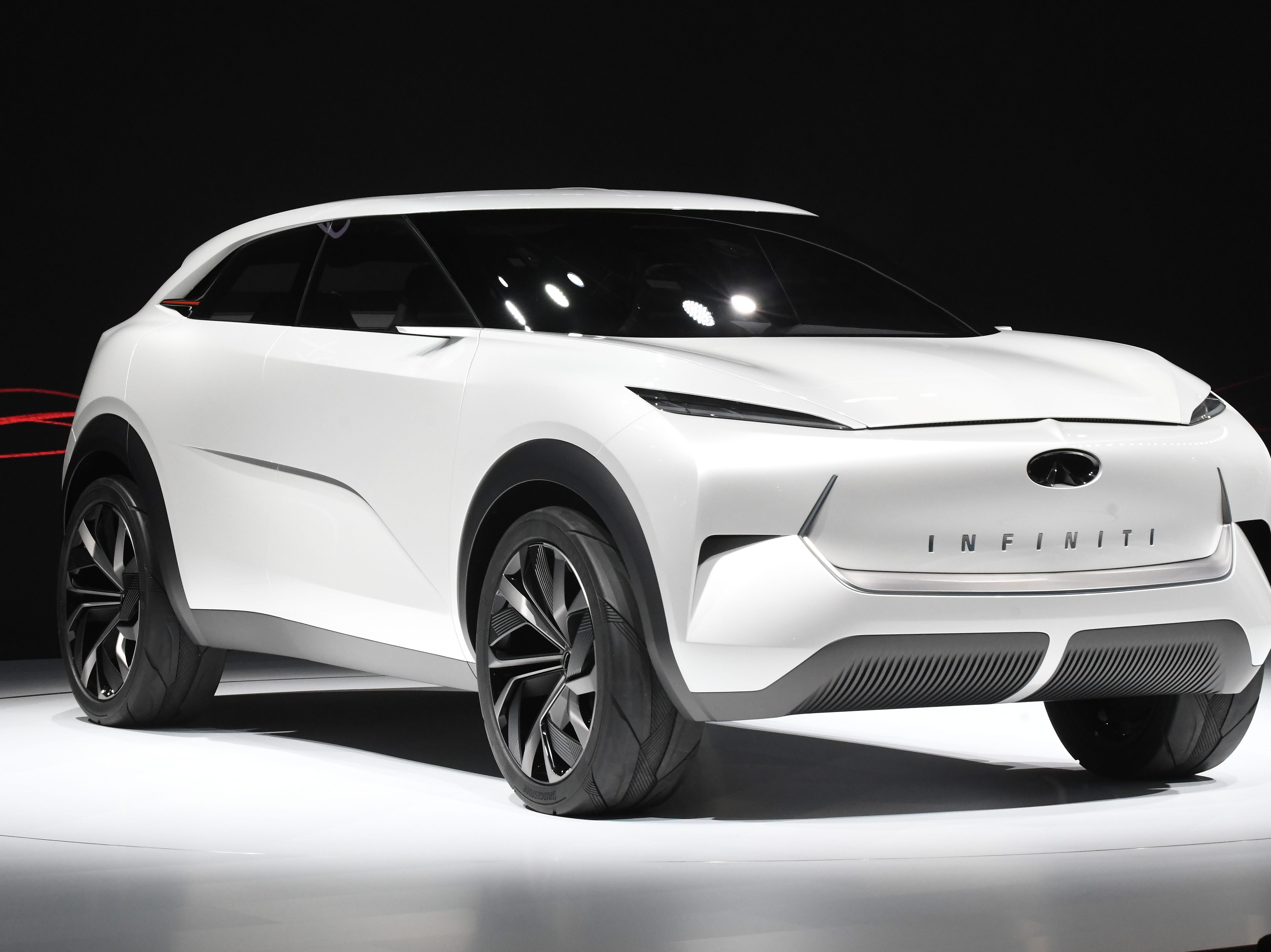 The Infiniti QX Inspiration concept vehicle is finally on display in Detroit after being pushed onto the show floor and uncovered.