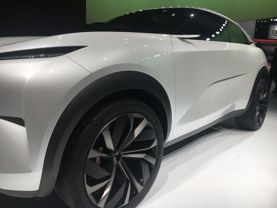 The Infiniti QX on the auto show floor after a a mechanical problem with the vehicle prevented company officials from rolling it out to be seen by the international media as planned.