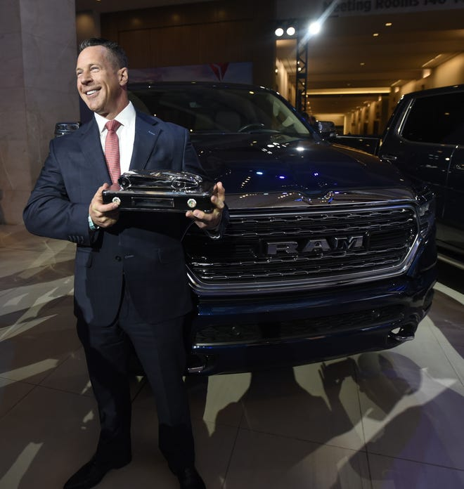 Reid Bigland, head of Ram brand, accepts the award for the 2019 North American Truck of the Year for the Ram 1500 on Monday in Detroit.