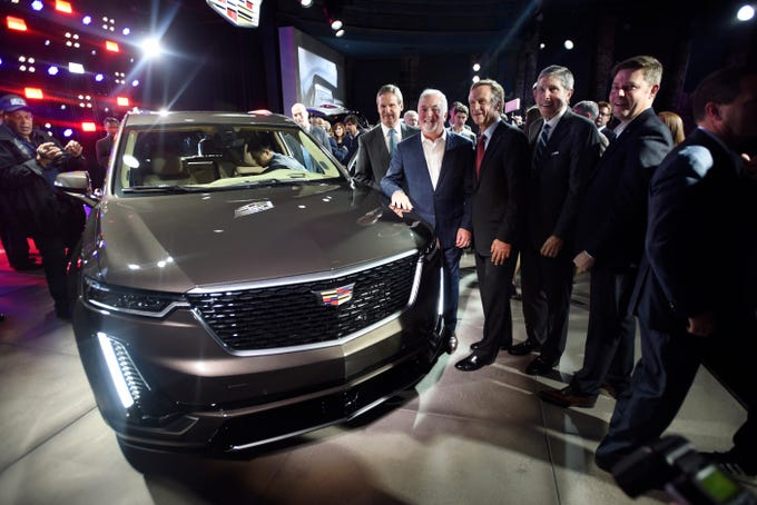 From left, Tennessee Gov.-Elect Bill Lee, Cadillac President Steve Carlisle, current Tennessee Gov. Bill Haslam, Tennessee Commissioner for the Dept. of Economic and Community Development Bob Rolfe, and Cadillac Design Executive Director Andrew Smith gather around the newly unveiled 2020 Cadillac XT6 Sunday, Jan. 13, 2019 at the Garden Theater in Detroit.