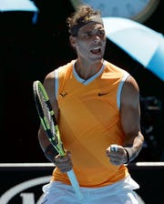 Spain's Rafael Nadal celebrates after defeating Australia's James Duckworth in their first round match at the Australian Open tennis championships in Melbourne.