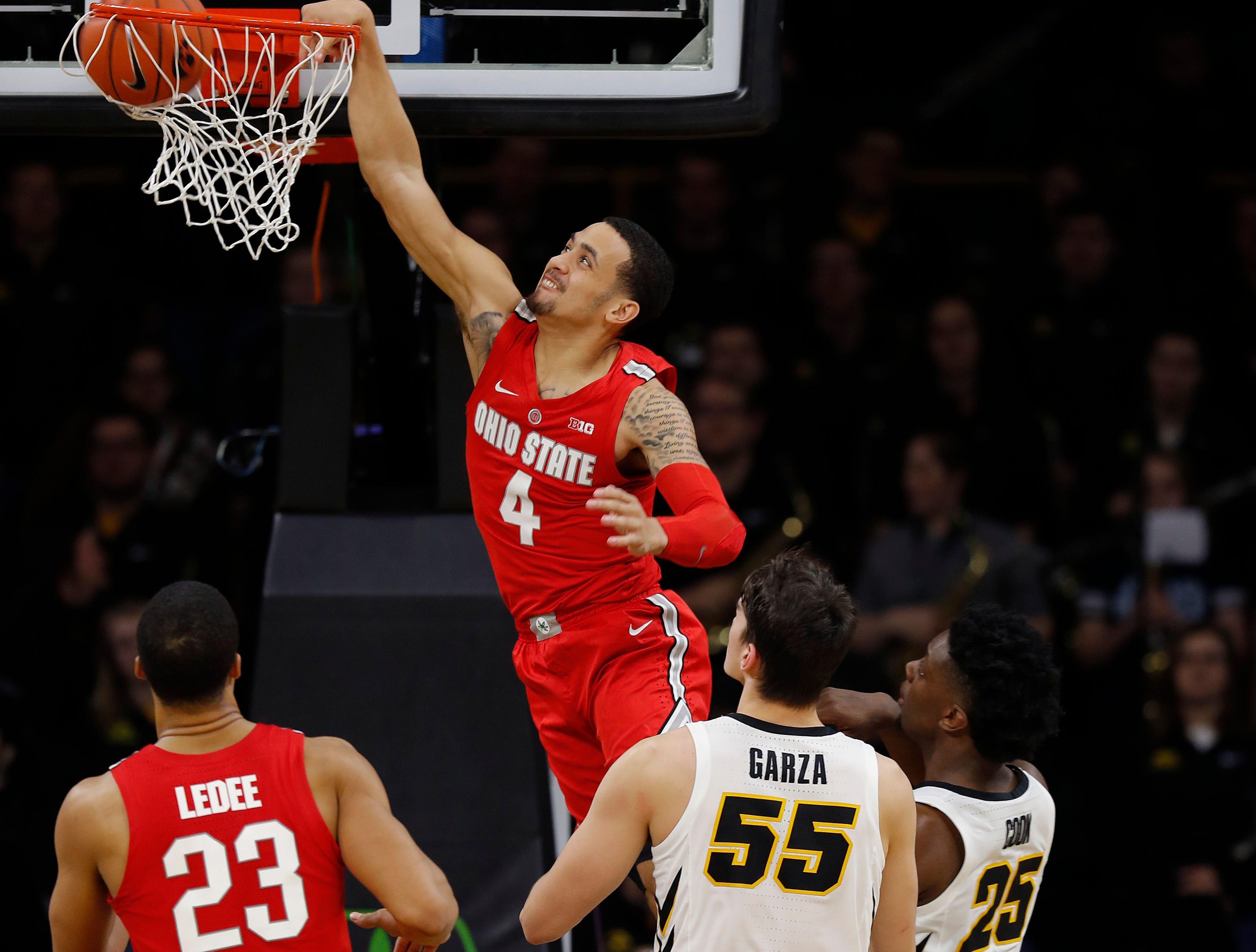 Ohio State guard Duane Washington, center, dunks during the second half of an NCAA college basketball game against Iowa, Saturday, Jan. 12, 2019, in Iowa City, Iowa. Iowa won 72-62. (AP Photo/Matthew Putney)