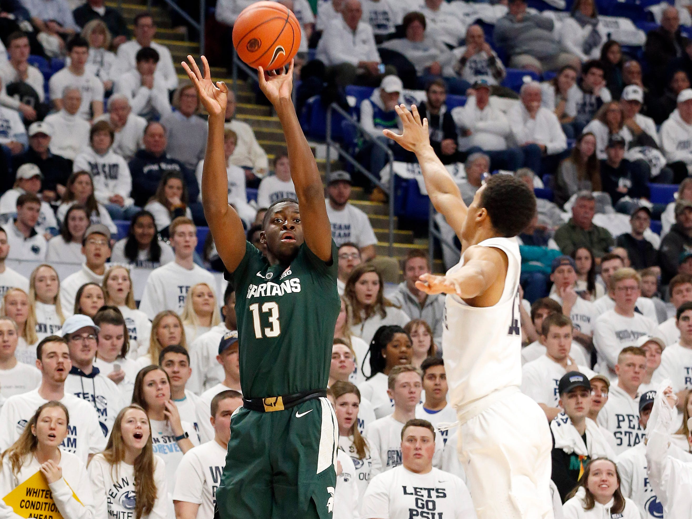 Michigan State's Gabe Brown (13) shoots a three-point basket as Penn State's Rasir Bolton (13) defends during first half action.