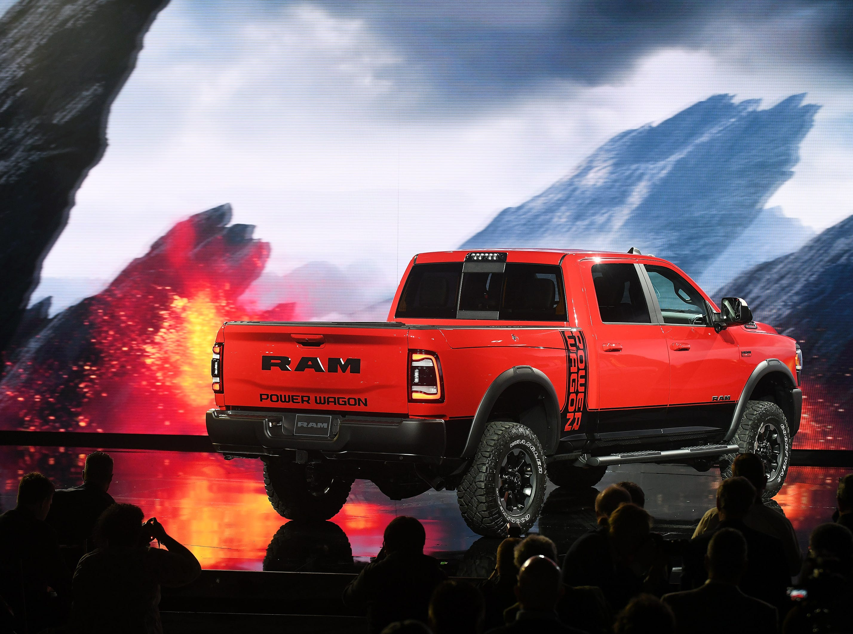 The 2019 Ram Power Wagon is displayed in front of a hot background on the stage at the Detroit Auto Show.