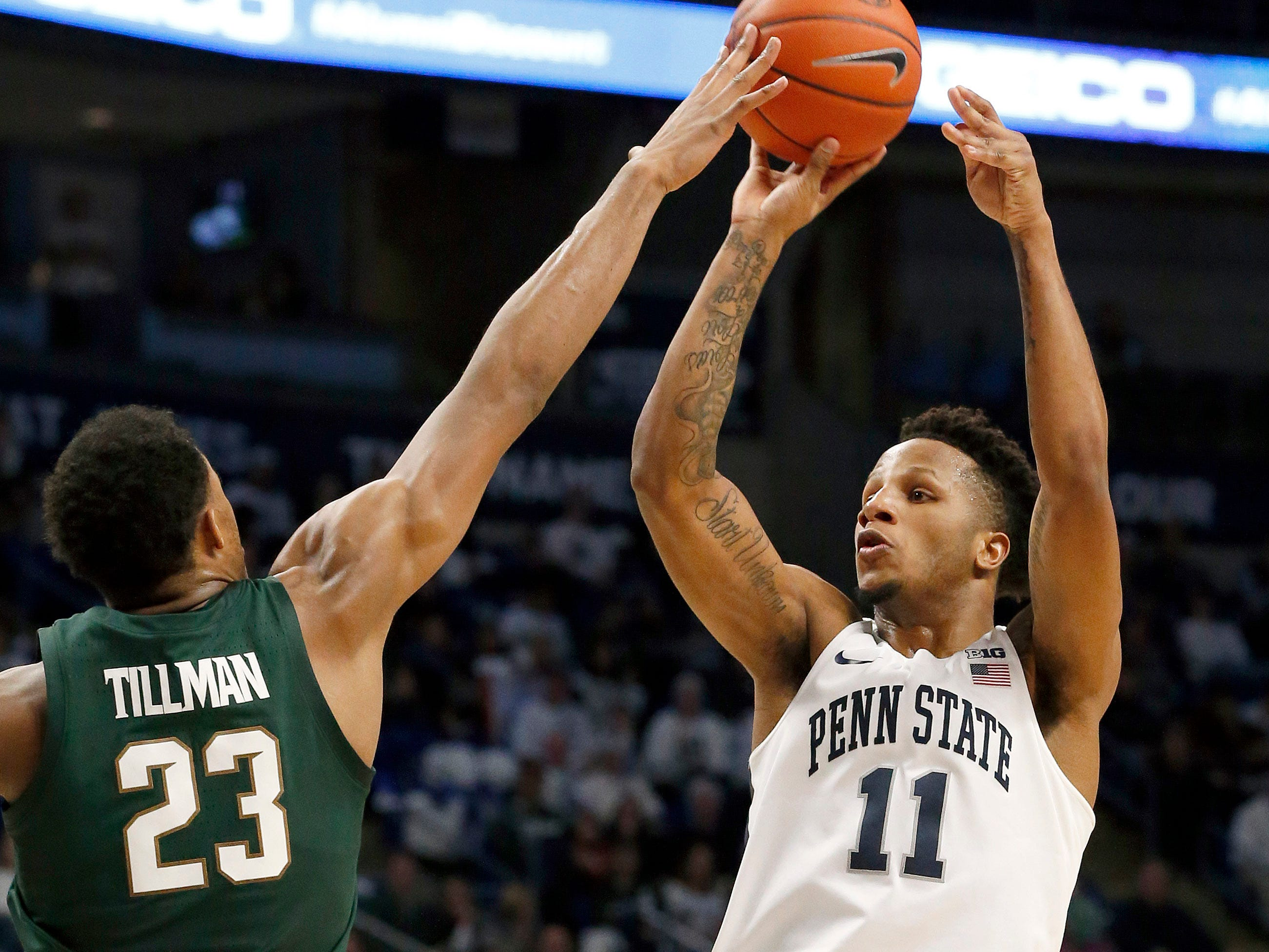 Penn State's Lamar Stevens (11) shoots against Michigan State's Xavier Tillman (23) during second-half action.