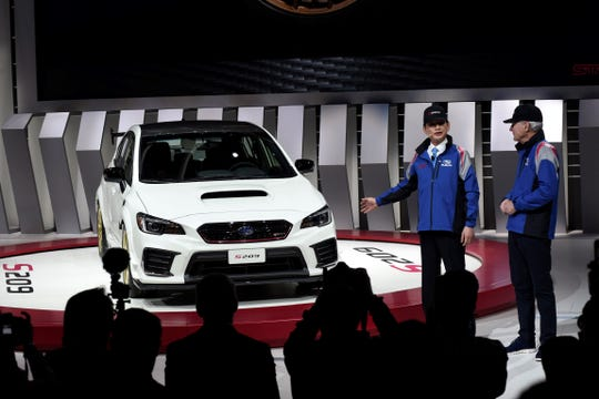Subaru Tecnica International President Yoshio Hirakawa, left, and Subaru of America Inc. President CEO Tom Doll talk after the unveiling of the S209 at the Detroit Auto Show Monday. The car is now available for the first time in America.