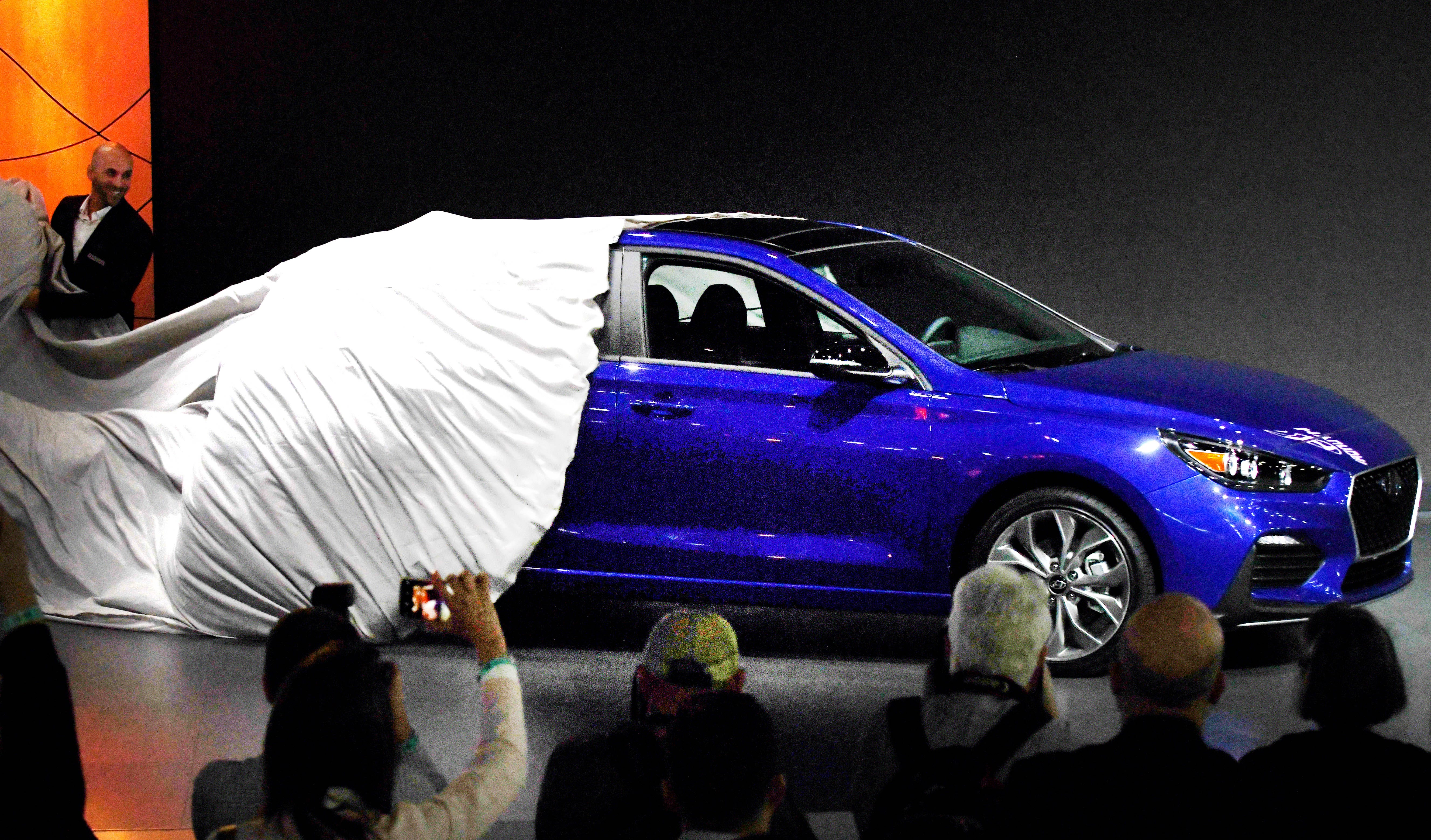 The wraps come off the Hyundai Elantra GT N Line in its debut Monday, Jan. 14, 2019, at the North American International Auto Show.