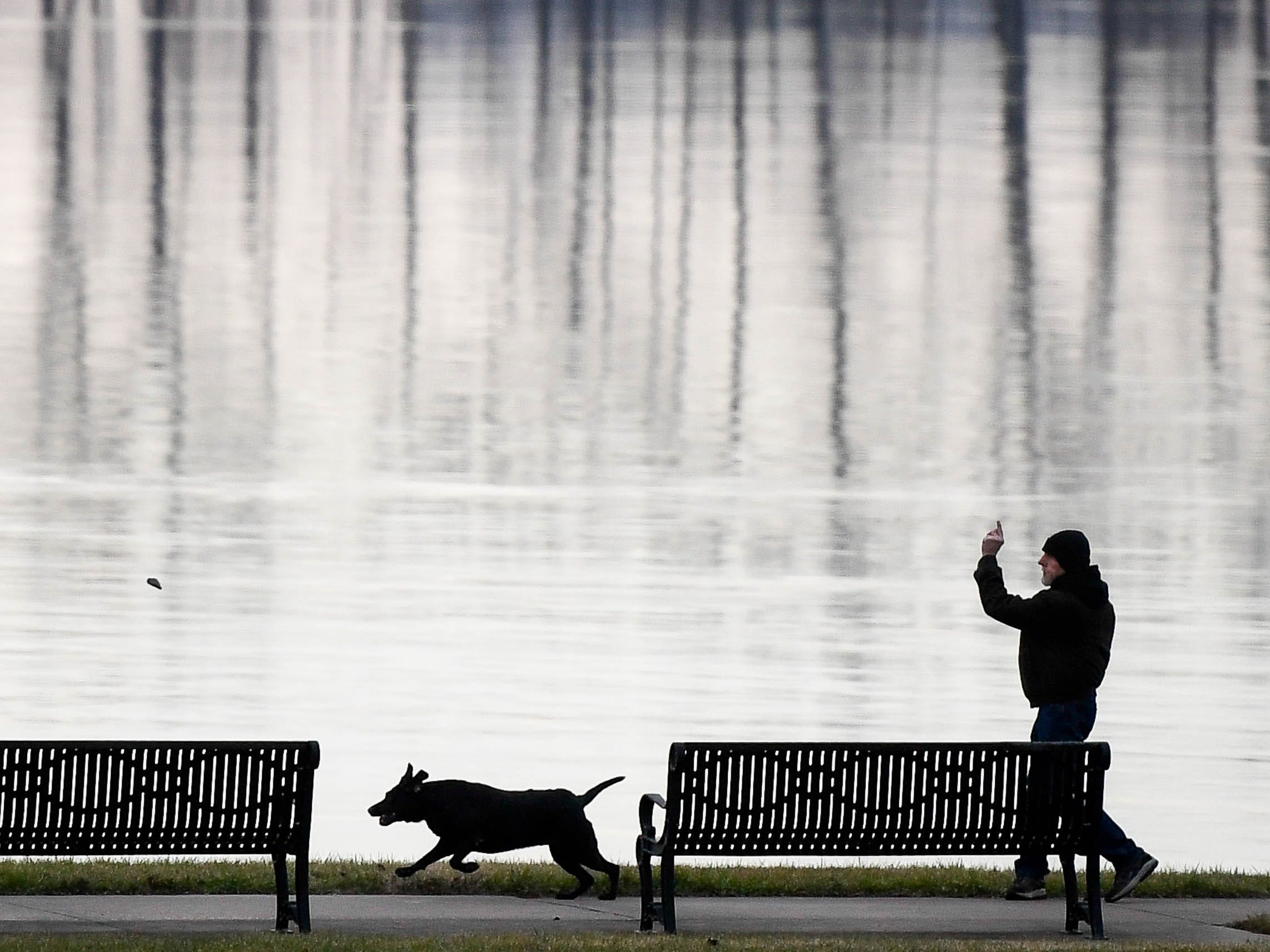 Frequent visitor John Hovenstine, Henderson, plays with his Lab-Hound mix Maggie at Redbanks Park in Henderson Thursday evening, January 3, 2019.