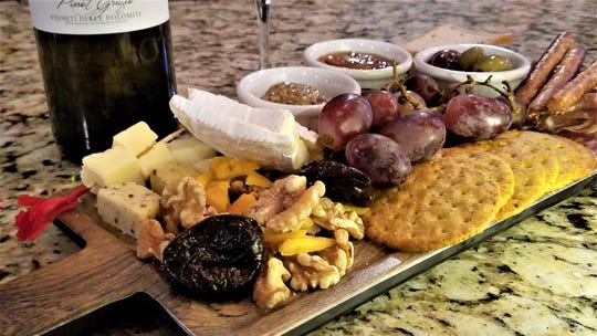 A charcuterie platter perfectly complements a before dinner glass of wine at the Wine Down.