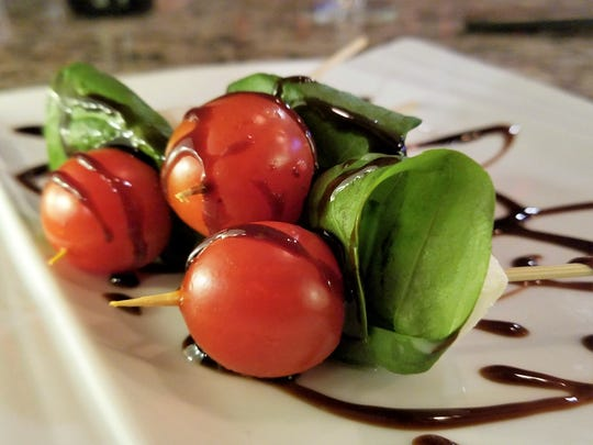 Caprese skewers at the Wine Down contain fresh mozzarella, basil and cherry tomatoes with a drizzle of balsamic.