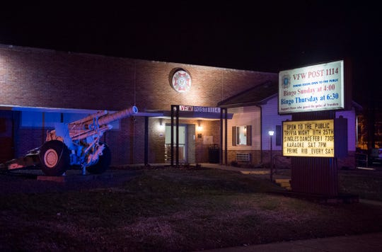 Police lights reflect off the VFW Post 1114, 110 N. Wabash Ave. in Evansville, Ind., after a shooting in the Bingo Hall Sunday, Jan. 13, 2019.