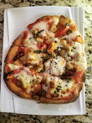 One of the Wine Down's flatbreads, such as this Florentine, can be shared or serve as a light entree.
