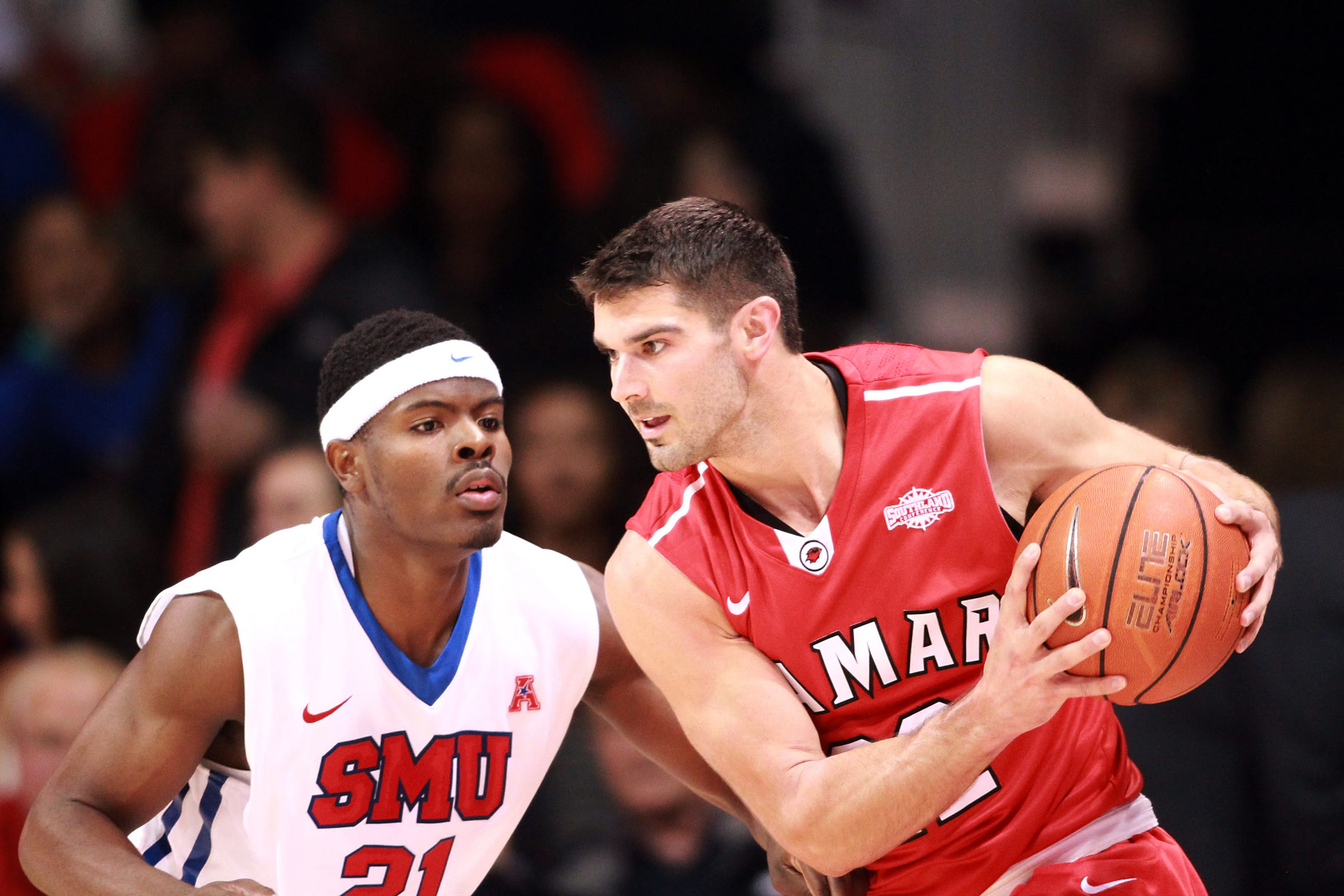 Lamar's Preston Mattingly looks to pass to a teammate as he is defended by a SMU player at a game in Dallas on Nov. 14, 2014.