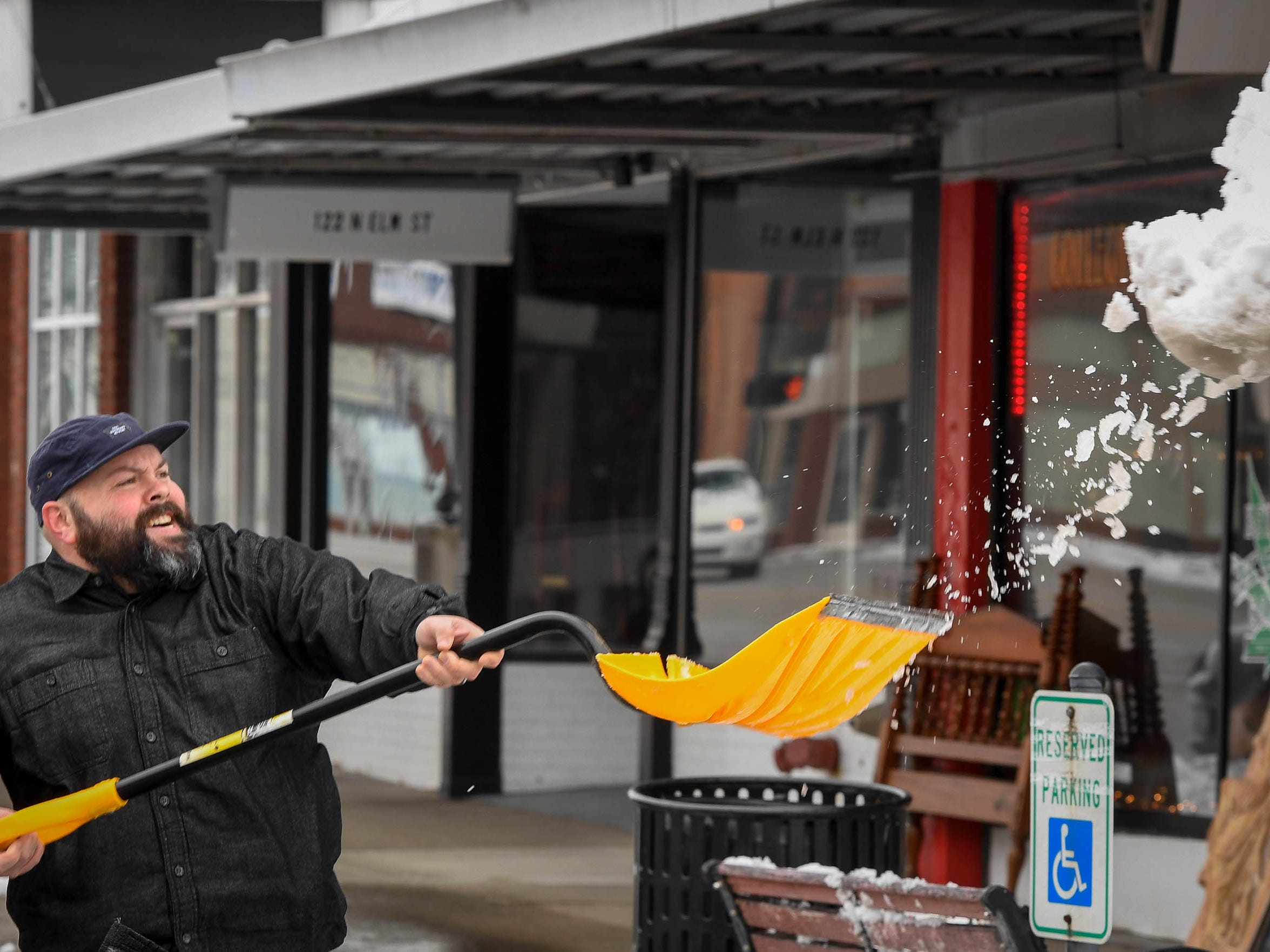 Matt Glick, Henderson, busy with the morning chore, shoveling snow in front of his dad's antique store on Elm Street in downtown Henderson Saturday, January 12 2019.