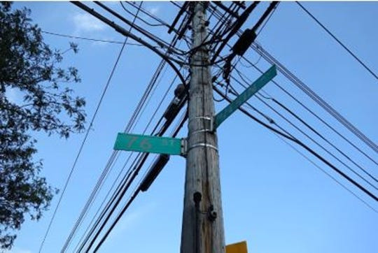 The typical utility pole runs about 40 feet in length, of which six feet are buried in the ground.  In urban environments they are commonly spaced about 125 feet apart while in rural areas the distance is more like 300 feet.