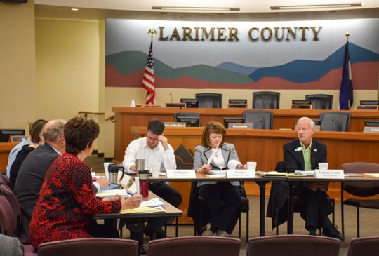 Larimer County Commissioner Steve Johnson, right, addresses fellow members of the Larimer County Behavioral Health Policy Council during its inaugural meeting on Jan. 14, 2019.