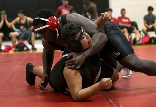 Adolphus Taylor of North Fort Myers High School wrestles Francisco Hernandez during the Ray Worsham Memorial Duals on Saturday, January 12, 2019, at North Fort Myers High School.