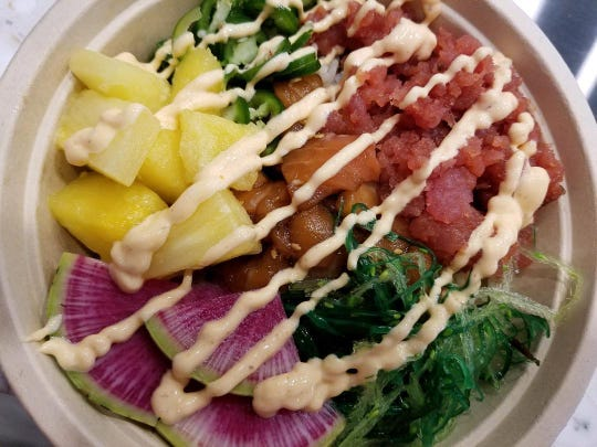 A poke bowl with spicy tuna and salmon from Poke Fusion in Estero.