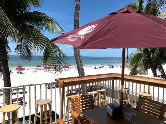 Outdoor restaurants seating, such as this deck at Lani Kai on Fort Myers Beach, will not be limited to 25% capacity but it will be limited to social-distancing guidelines.