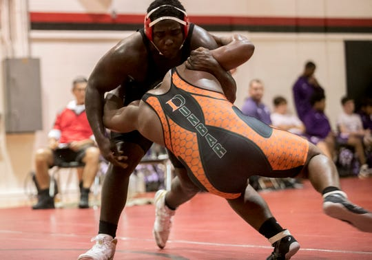 North Fort Myers wrestler Adolphus Taylorwrestles Jacquez Shird of Dunbar during the Ray Worsham Memorial Duals on Saturday, January 12, 2019, at North Fort Myers High School.