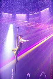 Roberto Colombo performs on the Chinese pole with Cirque Italia