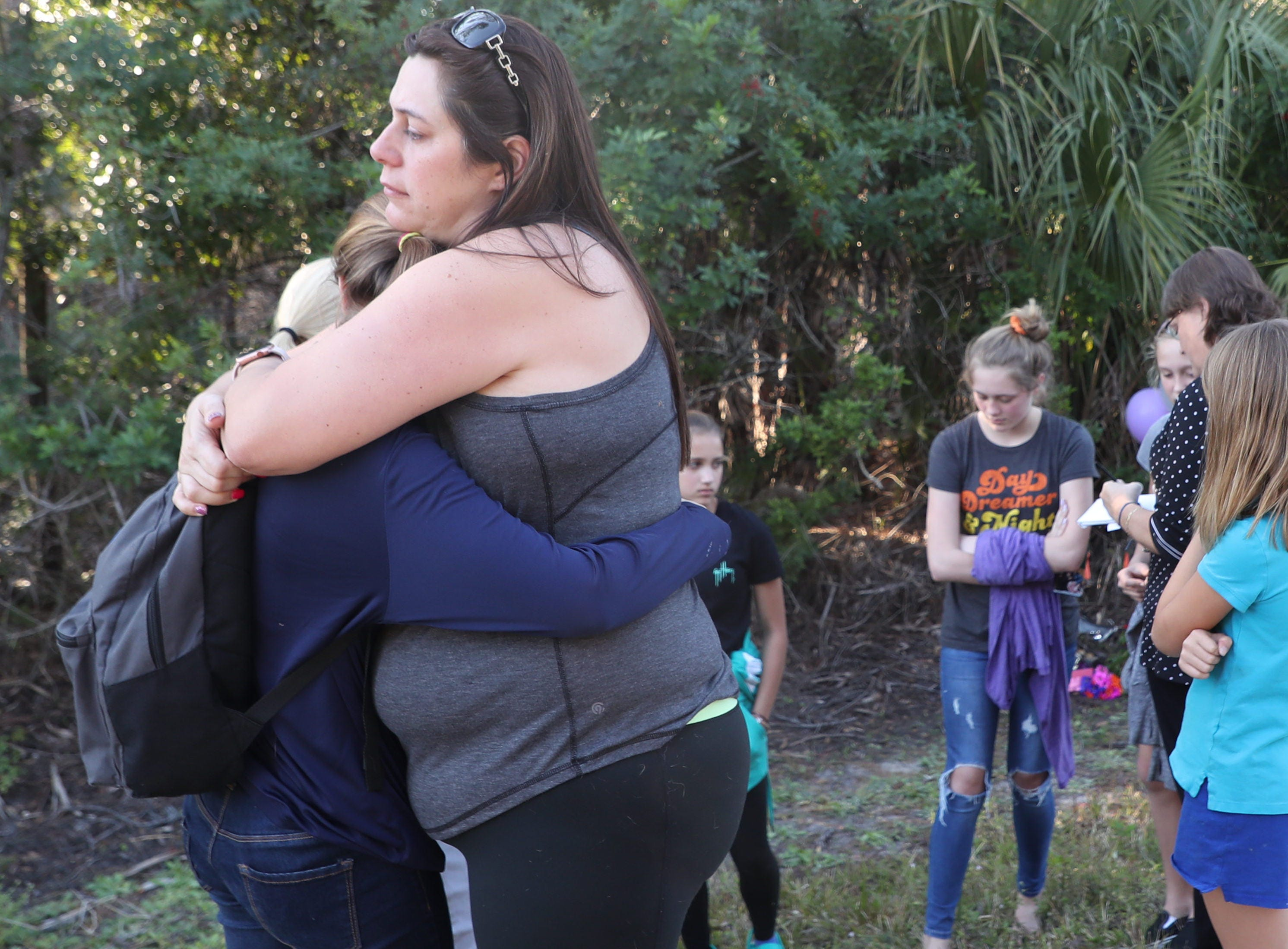 Family and friends of Alana Tamplin, 12,  gathered at a roadside memorial on Monday afternoon. Tamplin was killed by a driver while walking back home on Durrance Road after dropping her younger sister off at the bus stop on Monday morning.