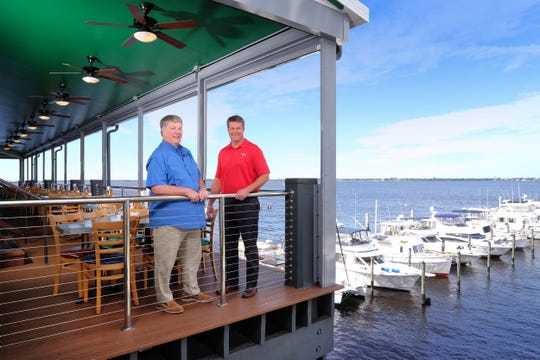 Tony Phelan, left, and his son Grant Phelan own Phelan Family Brands, the company behind Pinchers, Deep Lagoon Seafood and Texas Tony's Rib & Brewhouse.