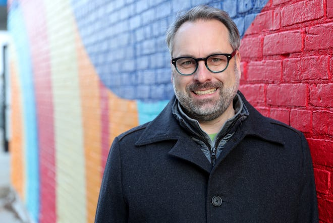Executive Director of On Broadway Inc., Brian Johnson in an alleyway behind House of Home Brew Friday, January 11, 2019 in Green Bay, Wis.