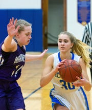Oconto's Leah Allan looks to get around the defense of Samantha Pieper of Marinette to make a pass.
