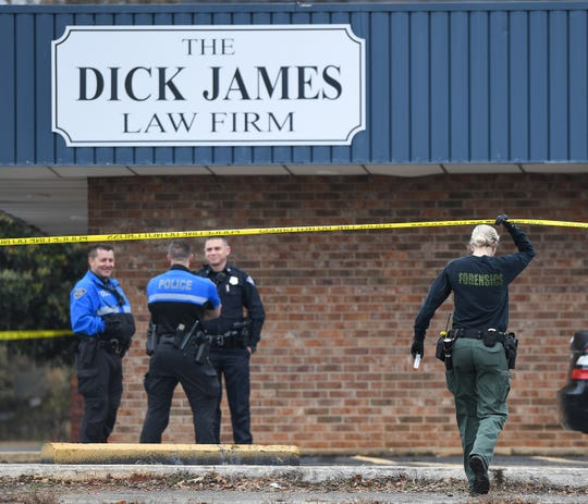 Law enforcement gather outside of the Dick James Law firm on Rutherford St. after a body was found in the building early Monday, January 14, 2019.